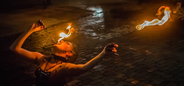 Allegra (Mary Beth Spurlock) of Phantasmagoria eats fire during the VIP aftershow following a performance at Lowndes Shakespeare Theatre July 25, 2015.